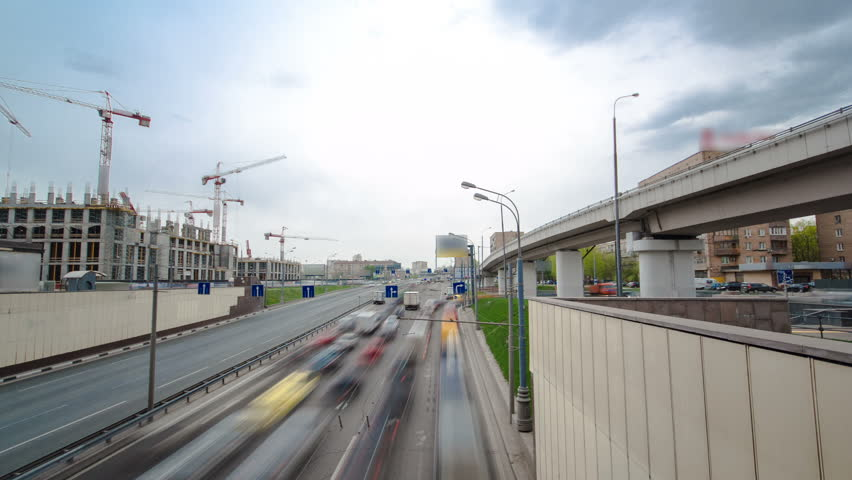 Top view of urban transport traffic on Begovaya street with overpass to Leningradskoye Highway timelapse hyperlapse. Leningradskoye Highway is a part of M10 federal highway Moscow to Saint Petersburg
