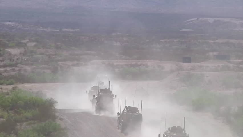 CIRCA 2010s - Marines on patrol in Afghanistan use mine sweeping trucks to detect IED's.
