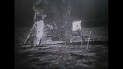 CIRCA 1970s - Astronauts from Apollo 11 walk on the moon.