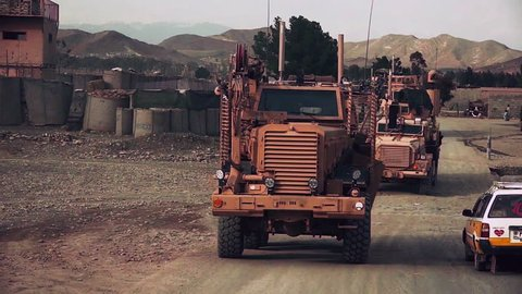 CIRCA 2010s - IED bomb sensing and disposal vehicles move along roads in Afghanistan.