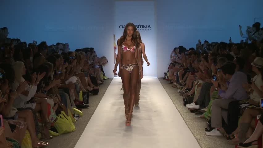 MIAMI USA - JULY 17, 2011. Models walks runway fashion show finale of  Brazilian fashion brand Cia Maritima Swimwear during MBFW Miami Swim 2012 fashion week. Miami, July 17, 2011.