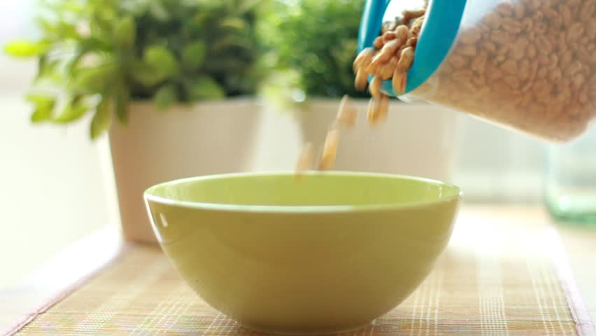 Pouring cornflakes into a bowl, slow motion