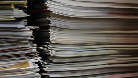 Stacks of old papers, old office documents, old paper work.