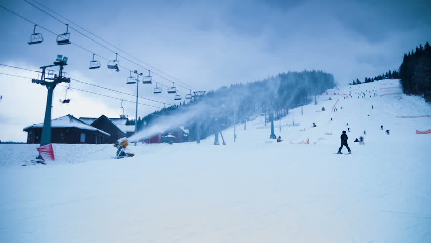 Night skiing and snowboarding at a ski resort in the included spotlights and running ski lifts. Ski resort. Timelapse | Shutterstock HD Video #13399424