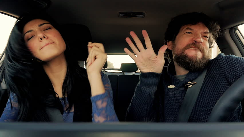 Funny man and woman dancing like crazy in car slow motion   Shutterstock HD Video #13424207