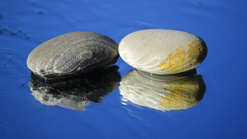 Clean water around the two small pebbles