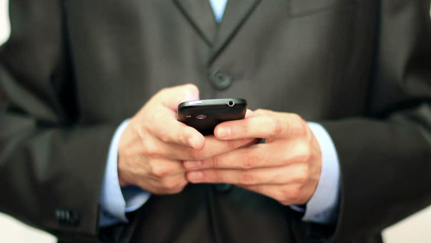Businessman using mobile phone for text messaging