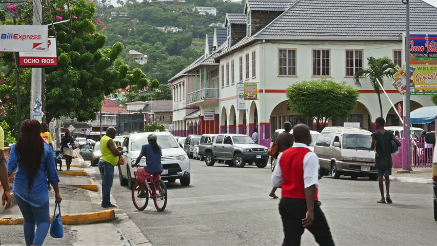 OCHO RIOS, JAMAICA - NOVEMBER 2015:Local pedestrian and vehicle traffic  during daily commute in the cruise ship destination port of Ocho Rios on the scenic north shore  of Jamica in Saint Ann Parish.