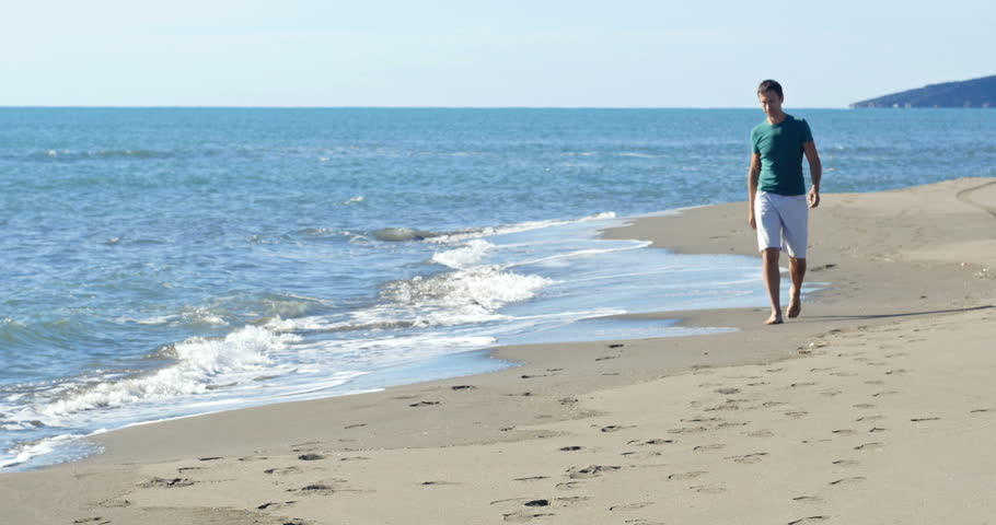 Man Walking On The Beach Stock Footage Video 100 Royalty Free 13503524 Shutterstock