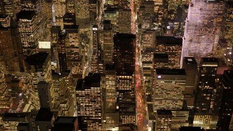 establishment shot of big city metropolis at night. illuminated cityscape skyline background