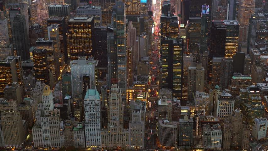 Establishment shot of city skyline metropolis at night. illuminated cityscape background. urban business district | Shutterstock HD Video #13557890