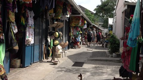 OCHO RIOS, JAMAICA - NOV 2015: Jamaica Ocho Rios local market shops. Christopher Columbus arrived 1494. Leading sugar exporter. Climate is tropical ecosystem. 90% of population from early slaves.