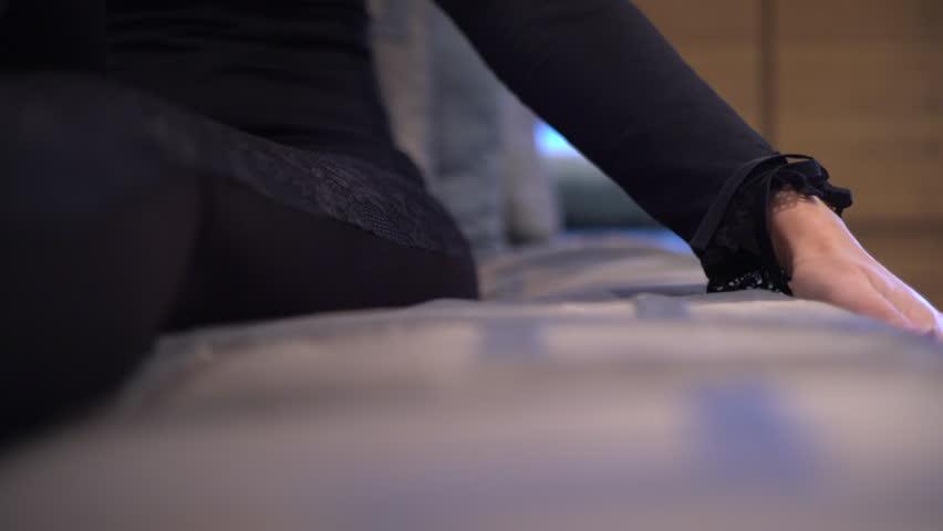 Woman hand touching hotel bed   Shutterstock HD Video #13590044