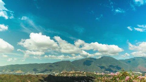 Time lapse sequence of tropical clouds moving along a capital city. Caracas, Venezuela. 4k-3840 x 2160.