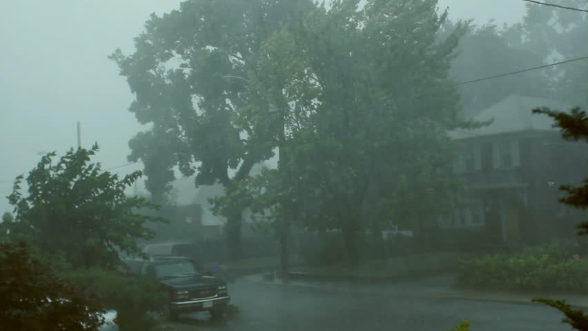 Scary suburban storm. Very strong summer storm with close to hurricane force winds. Thunder and lightning. East York, Ontario, Canada.