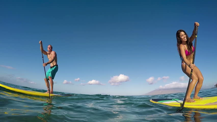 Active Couple Stand Up Paddling In Hawaii, Summe Sport