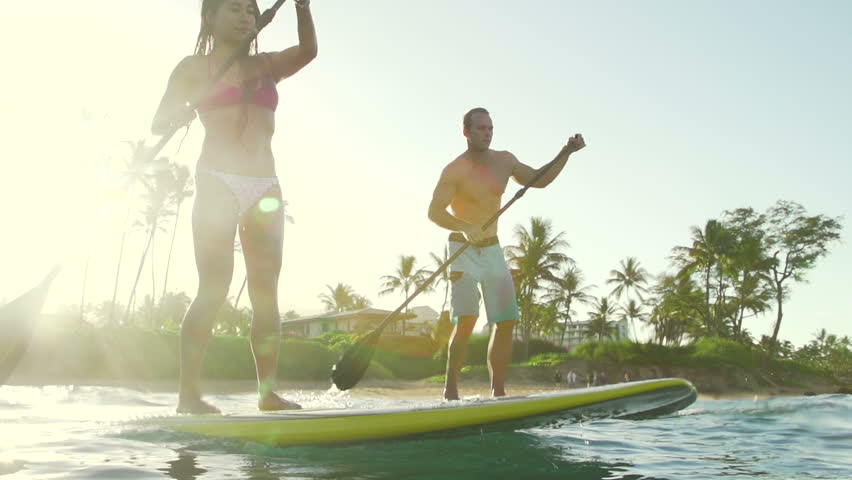 Happy Couple Stand Up Paddle Surfing, Summer Sport