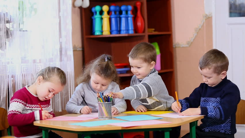 Children draw crayons at the table | Shutterstock HD Video #13630934