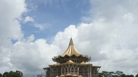 SARAWAK RIVER, KUCHING, BORNEO - DECEMBER 2015: The Sarawak state parliament building seen from the Sarawak River in Kuching, Borneo