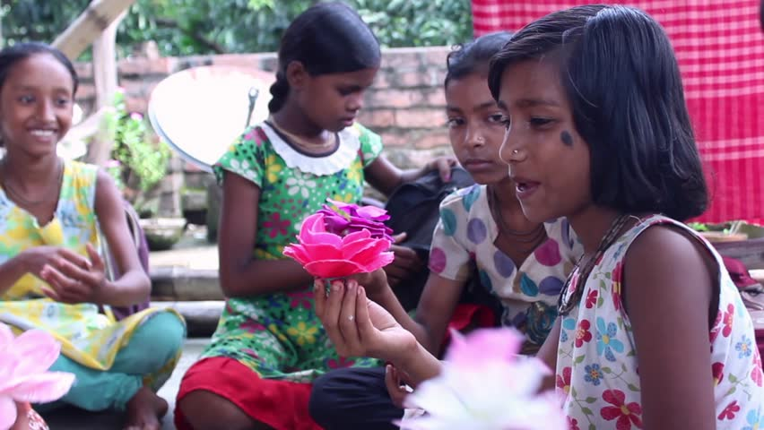 Group Of Girl Students In An Indian Village School Make Paper Flowers