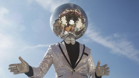 mr discoball. a super cool disco club character enjoying some summer sunshine