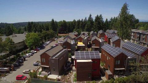 ULTRA HD 4K Aerial view of solar panels on building rooftops - Grow Community Bainbridge Island, Washington, USA