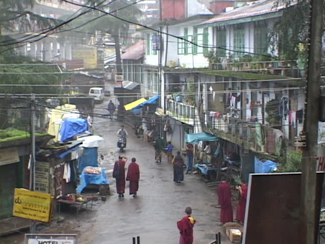 DHARAMSALA, INDIA - CIRCA 2010: Rain falls on the Buddhist village of Dharamsala, India circa 2010 in Dharamsala, India. Several thousand Tibetan exiles have now settled in Dharamshala, where they have built monasteries, temples and schools.