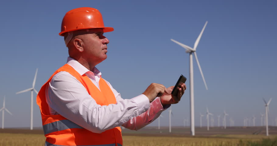 Engineer manager check blueprint technical drawing wind turbine engineer use tablet planning future location wind turbine best spin rotation 4k stock video clip malvernweather Images