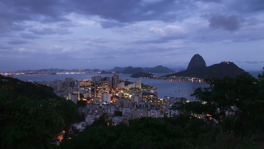 Time-lapse transition from dusk to night with zoom in overlooking downtown Rio, the Sugarloaf mountain and Guanabara bay    Shutterstock HD Video #13820894