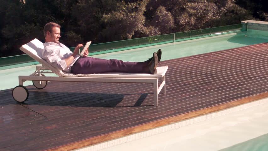 Man using tablet in the garden in slow motion | Shutterstock HD Video #13823606