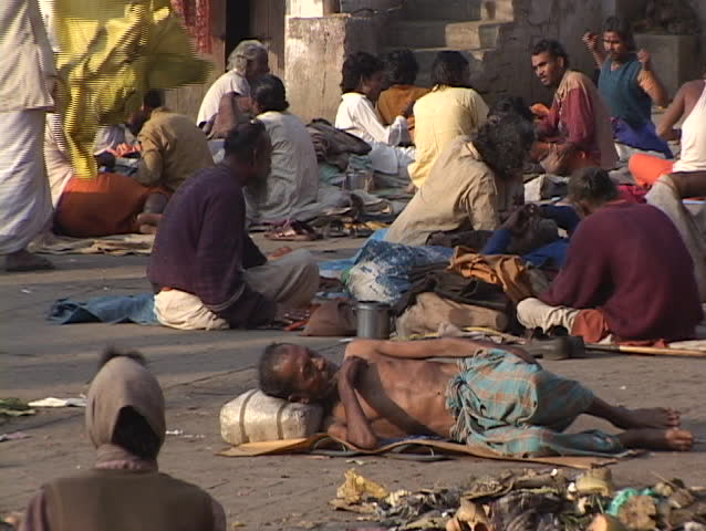 INDIA - CIRCA 2010: Poor people lay out on the ground circa 2010 in India.