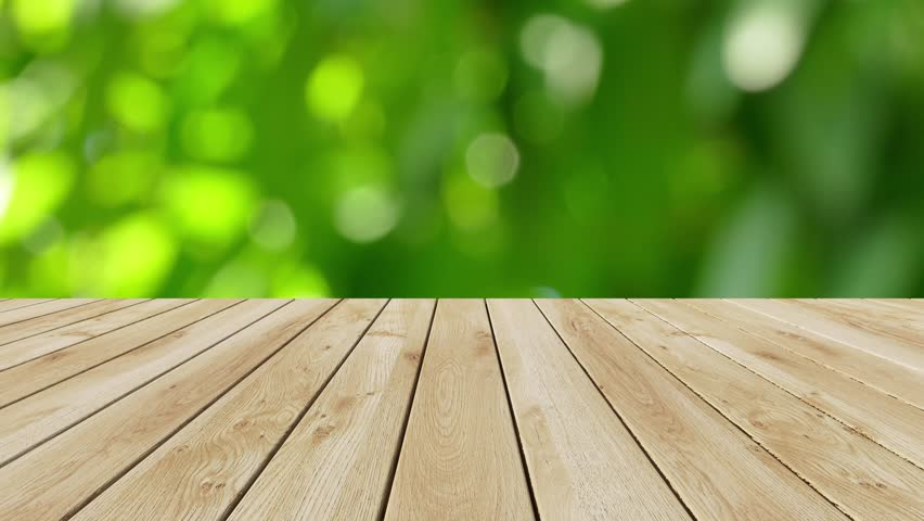 Wood Table Top On Blur Moving Natural Green Leaf ...