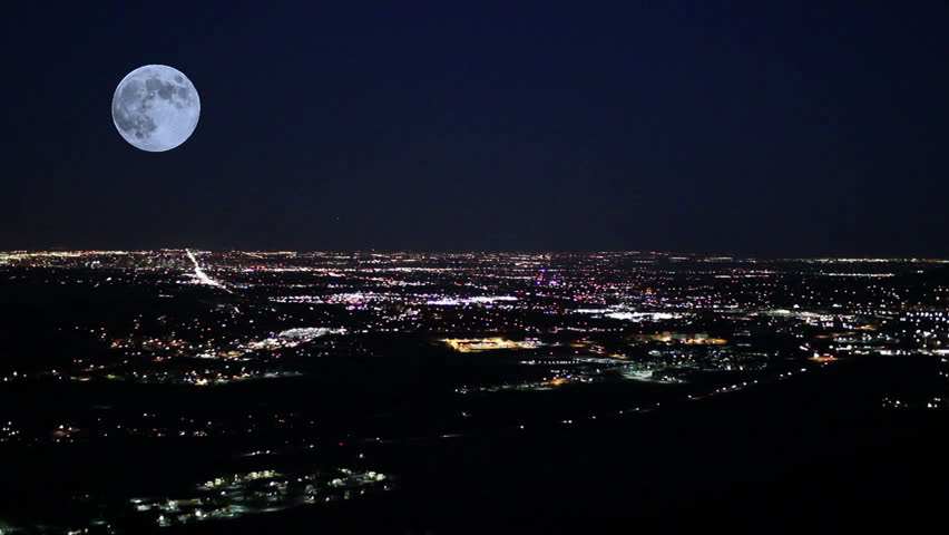 Moon over Denver at night with simulated blackout / power outage