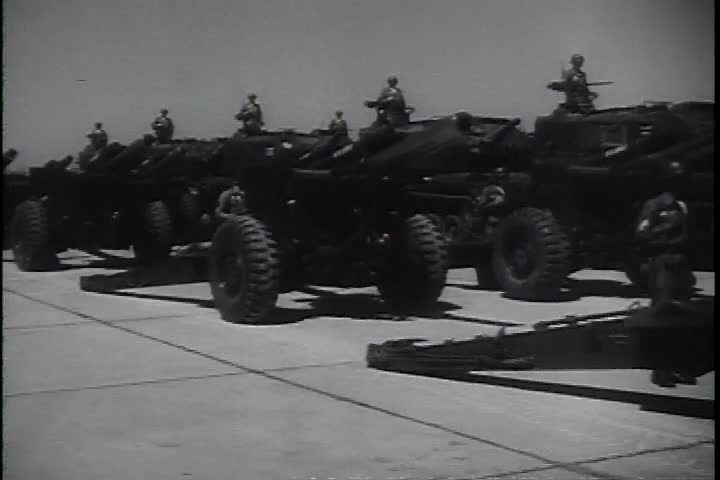 CIRCA 1970s - A big exhibit of cannons, war vehicles and several missiles show the force of the artillery in the 1970s. | Shutterstock HD Video #13890344