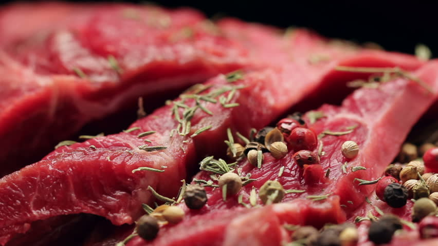 Fresh raw beef meat with peppercorns ready to grill, rotating | Shutterstock HD Video #13917554