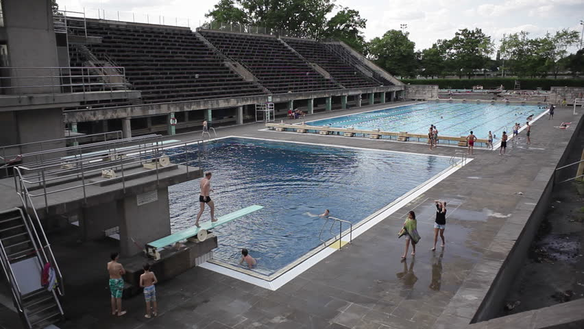 GERMANY   CIRCA JULY 2015   Man Jumps Off Diving Board At Berlin Olympic  Stadium Pool, Germany Stock Footage Video 13925354 | Shutterstock