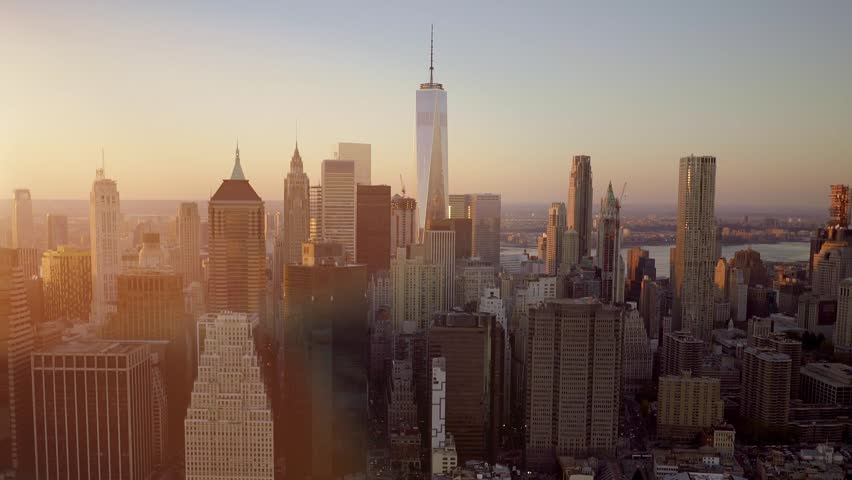 Aerial sunrise new york city skyline view of lower manhattan and establishing shot of city metropolis skyline cityscape view at sunset magic hour light hd voltagebd Image collections