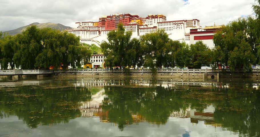 4k Potala reflection on lake in Lhasa park,Tibet.lake with willow. gh2_09749_4k
