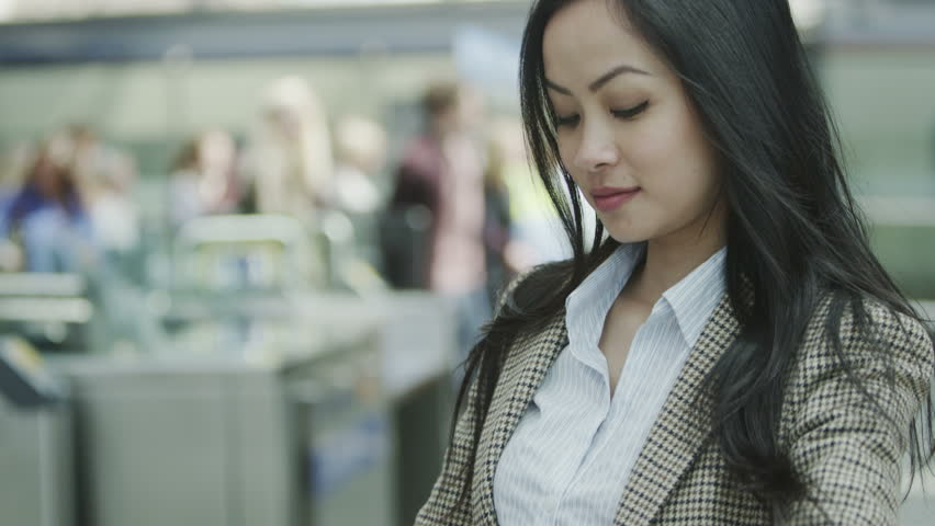 4k / Ultra HD version Attractive young woman at a railway station checks her watch as she waits for the arrival of a train. In slow motion. Shot on RED Epic | Shutterstock HD Video #14000090