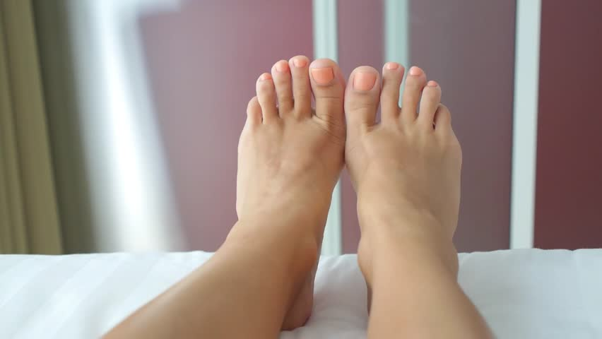 Woman Feet Dancing in Bed. Closeup.