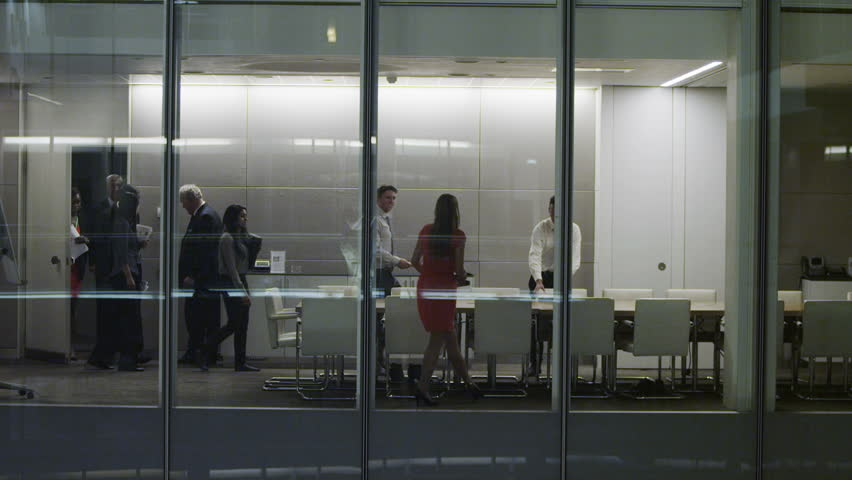4k / Ultra HD version Diverse business team in late night boardroom meeting in contemporary office. Shot on RED Epic   Shutterstock HD Video #14023124