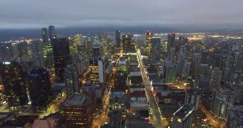 VANCOUVER,CANADA - CIRCA January 2016 :aerial right sweep over downtown at night
