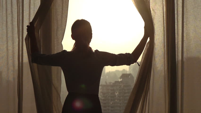 Woman  unveil curtains in room in the morning, 240fps  | Shutterstock HD Video #14070479