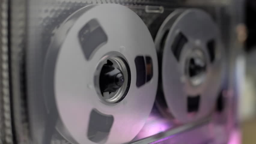 The cassette with silver and golden color is played in the tape deck recorder. Closeup. Follow focus. Shallow depth of field | Shutterstock HD Video #14075534