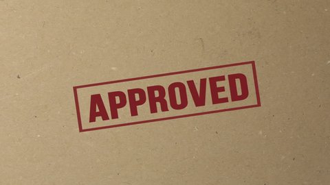 Shot of Approved signed with red ink stamp