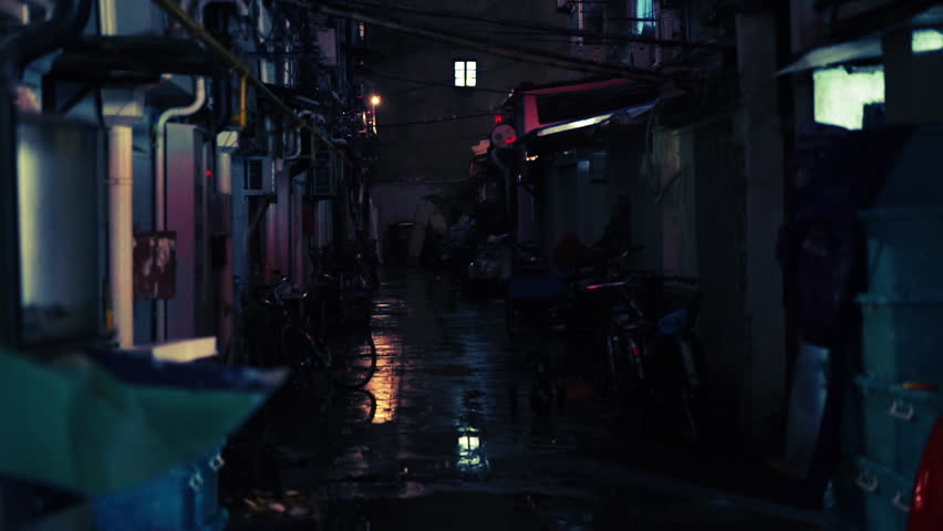 SHANGHAI - CIRCA DECEMBER 2015: Small alleyway in the Old French Concession district. Man crosses from doorway to doorway.