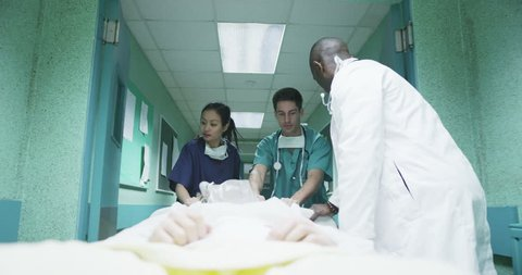 4k / Ultra HD version Hospital emergency team rush a patient on a gurney to the operating theatre. Shot on RED Epic