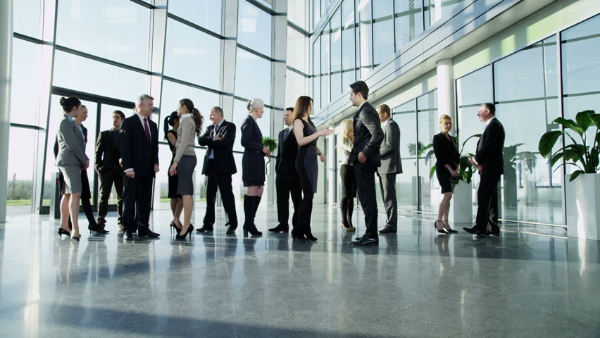 4k / Ultra HD version Diverse group of business people, stand and chat to each other in a light and modern glass fronted office building on a bright day. In slow motion. Shot on RED Epic   Shutterstock HD Video #14126954