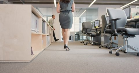 Closeup of Business power woman leader's feet walking through busy corporate office planning her next success strategy