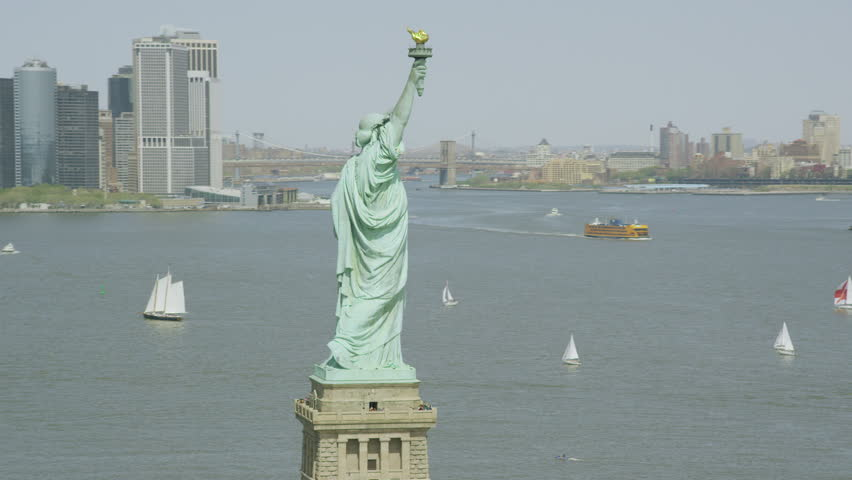 4k / Ultra HD version Helicopter aerial view of Statue of Liberty, New York City. Flying overhead we see the iconic American Lady Statue. Famous United States tourism attraction. Shot on RED Epic | Shutterstock HD Video #14150144